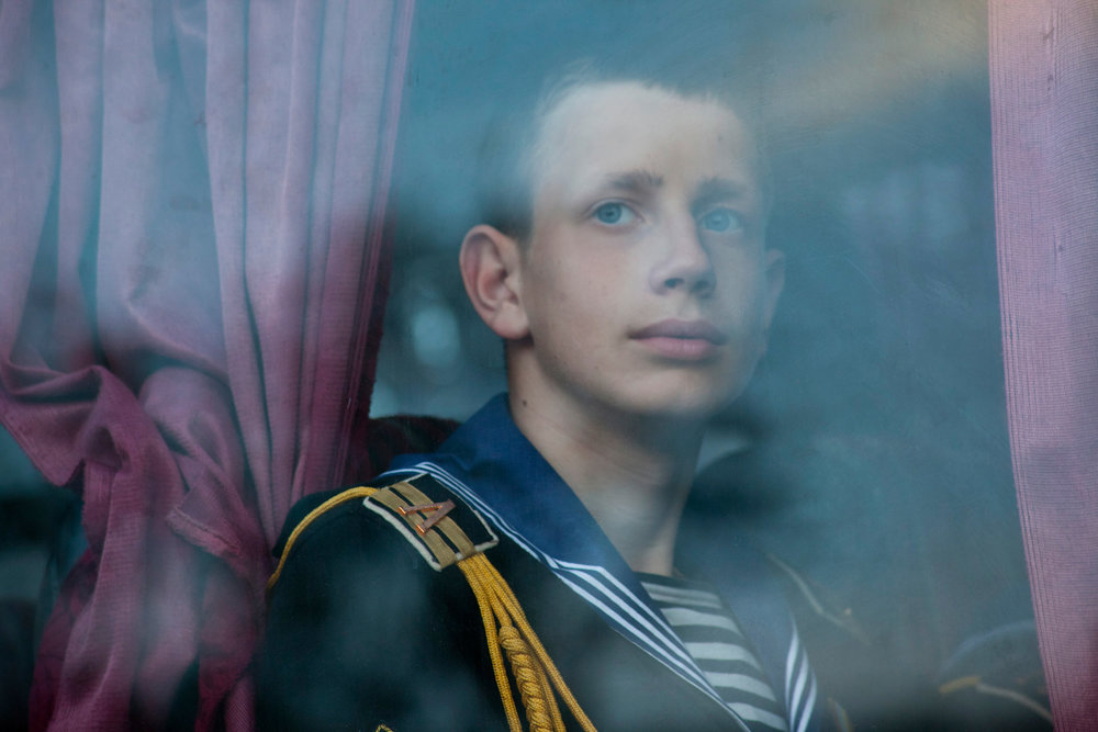 Yuri Perov, a Ukrainian naval cadet, takes the bus to his barracks after rehearsal for the Victory Day parade. To remember the sacrifice of fallen soldiers is viewed as a holy duty in Sevastopol, which endured a 247-day-long siege by Hitler's army in 1941-42.  Sevastopol, Crimea