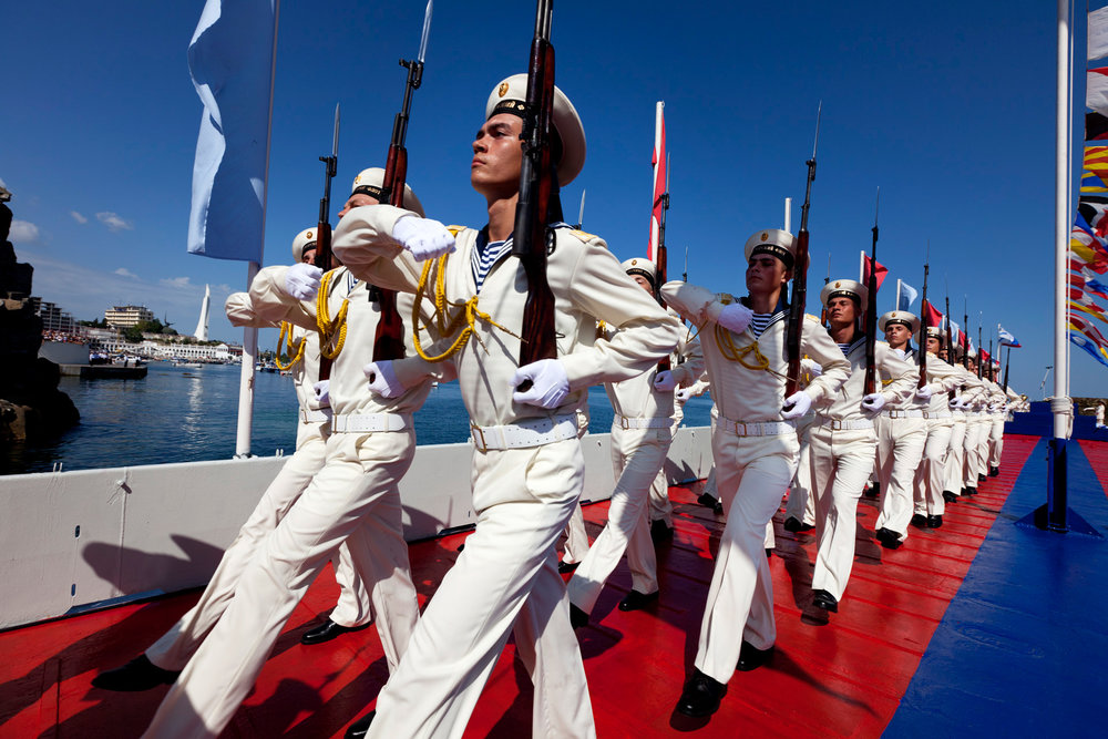 Navy soldiers march in meticulous unison on the Day of the Russian Fleet, one of the largest and most lavish celebrations in Sevastopol.  Sevastopol, Crimea