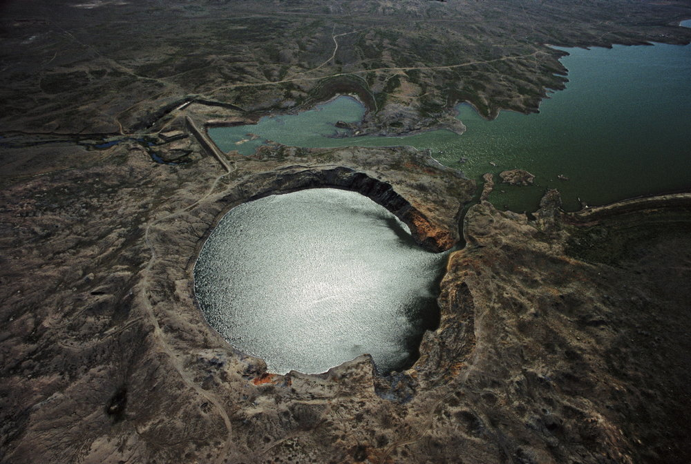 "The largest and most notable ""cratering shot"" detonation following the Partial Nuclear Test Ban Treaty took place in 1965 at the Chagan nuclear test site in Kazakhstan. Large amounts of radiation were vented when this reservoir (also known as ""Atomic Lake"") was created, exposing the downwind population.  Chagan, Kazakhstan"