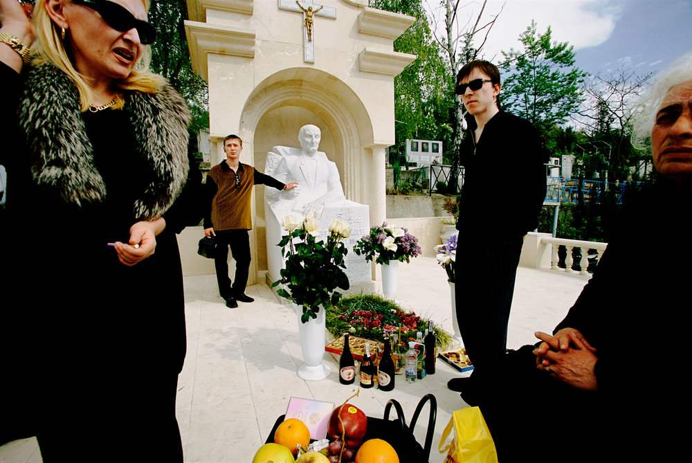 New Russians – probably part of the affluent mafia crowd – honor an old tradition: Gathering to wine and dine at the grave of a deceased relative on Parent's Day.  Sochi, Russia