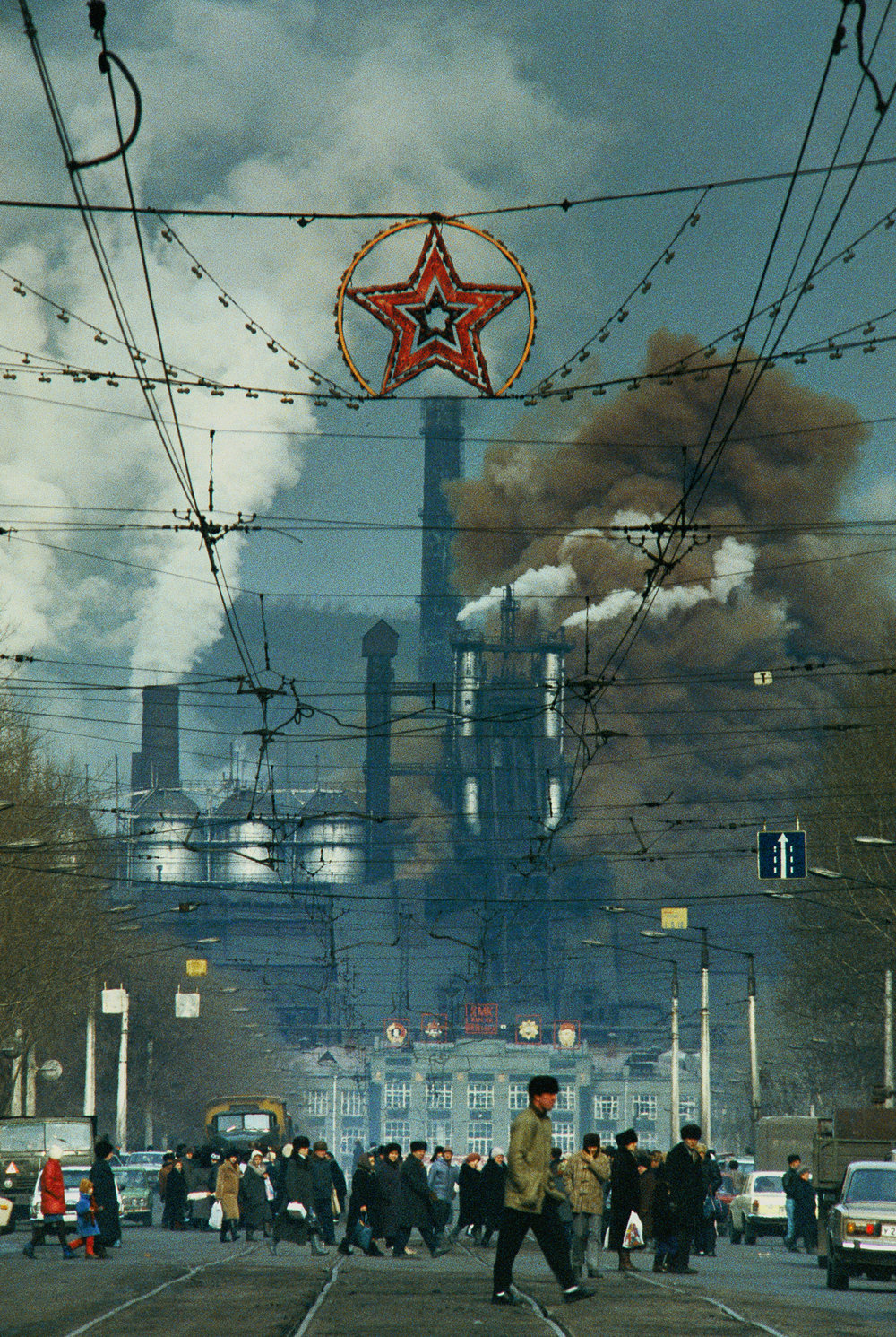 Smoke from the KMK steel plant belches carbon monoxide above this Siberian city. By the early 1990s, pollution had cursed 35 million Russians with unhealthy air.  Novokuznetsk, Russia