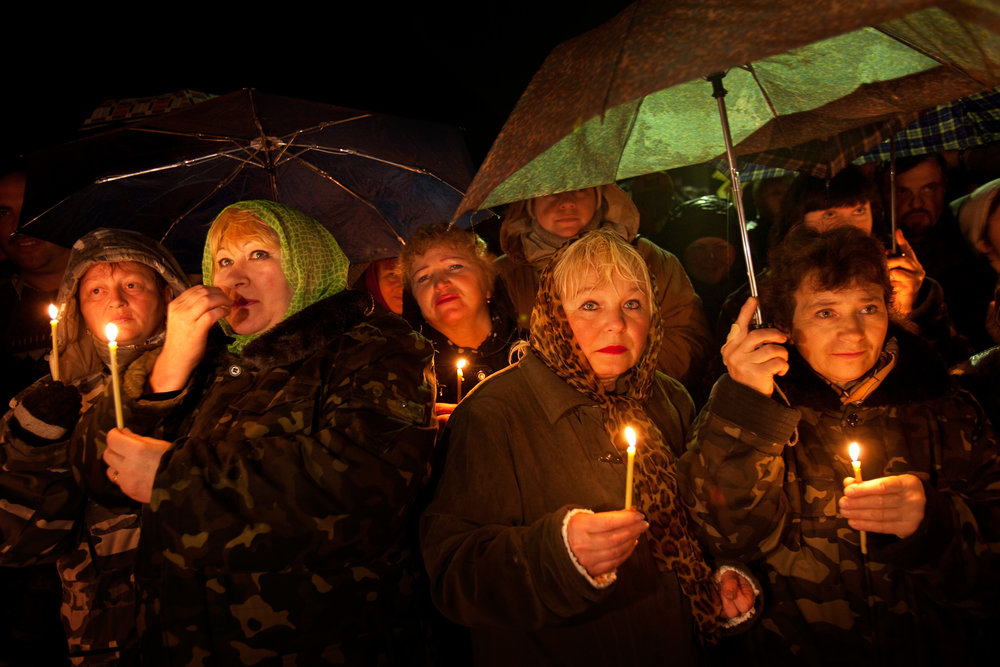 In a midnight gathering at the Monument to the Firemen, shift workers in Chernobyl honor those killed by the explosion on April 26, 1986.  Chernobyl, Ukraine