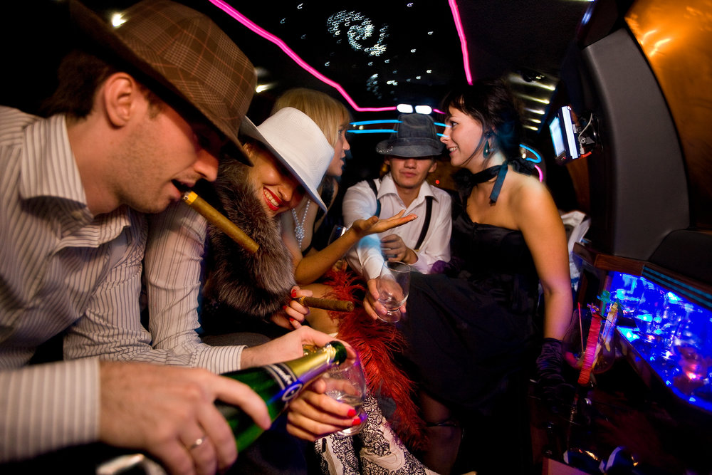 12:05AM - Members of Russia's new elite shop till they drop and party till dawn. This group of financial advisors has rented a white stretch limo to drink champagne and cruise the city.
