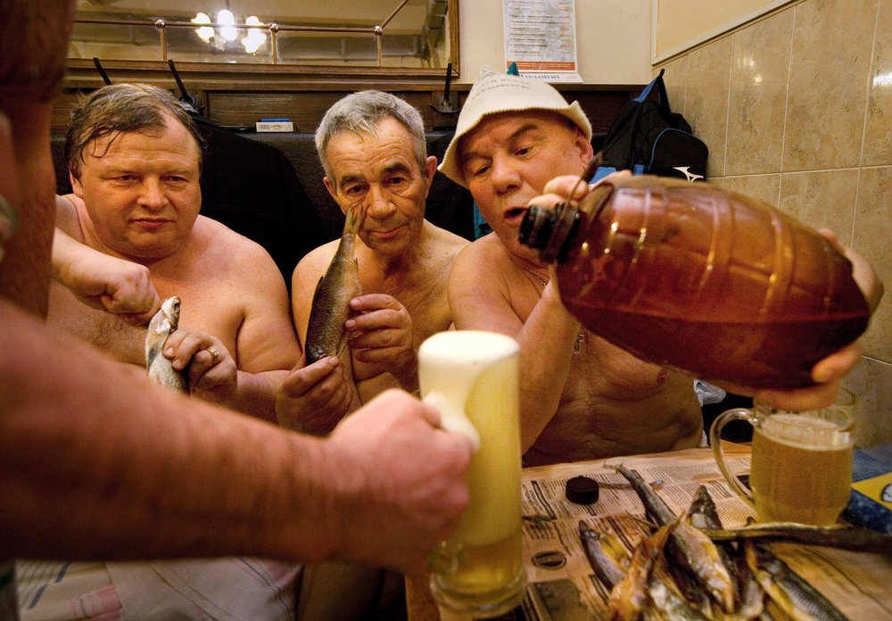 7:30PM - Friends Yevgeny, Anatoly, and Viktor polish off an evening with fistfuls of beer and smoked fish at the 200-year-old Sanduny baths, a traditional gathering place for the workaday crowd.