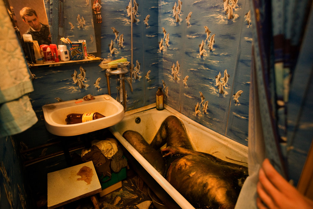 3:57 AM - An elderly alcoholic is discovered in his bathtub one month after his death.