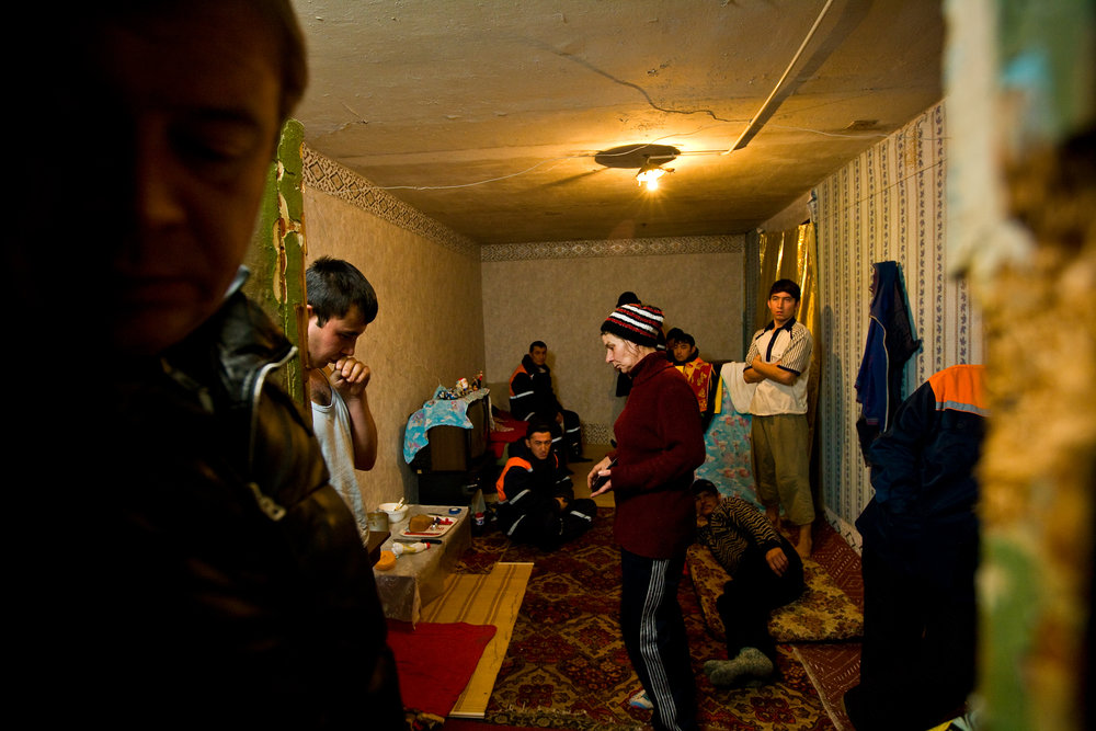 6:02 AM - Police raid a group of 'gastarbeiters', or illegal-immigrants, living in run-down and overcrowded apartments to arrest those without proper documentation.