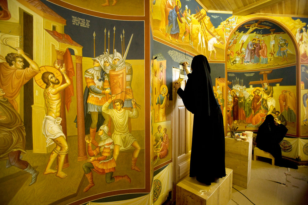 Novo-Tikhvinsky Convent nuns paint walls with religious motifs in a cloister complex that will serve as their abbot's future residence.  Yekaterinburg, Russia