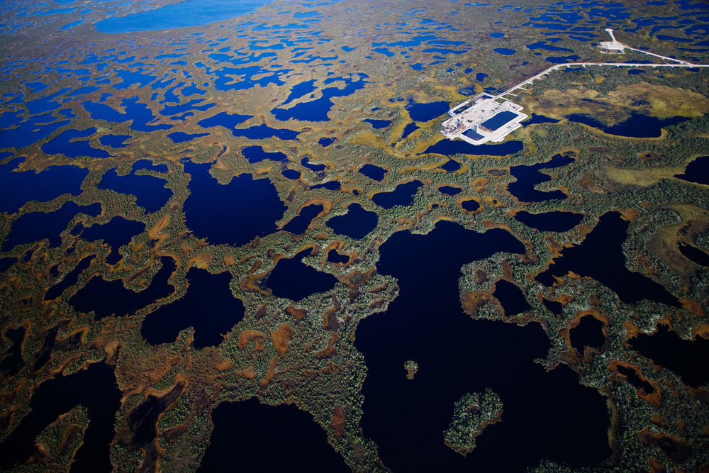 Near Kogalym, a LUKoil drill pad built atop fragile wetlands probes for new oil reserves.  Khanty-Mansiysk Region, Russia