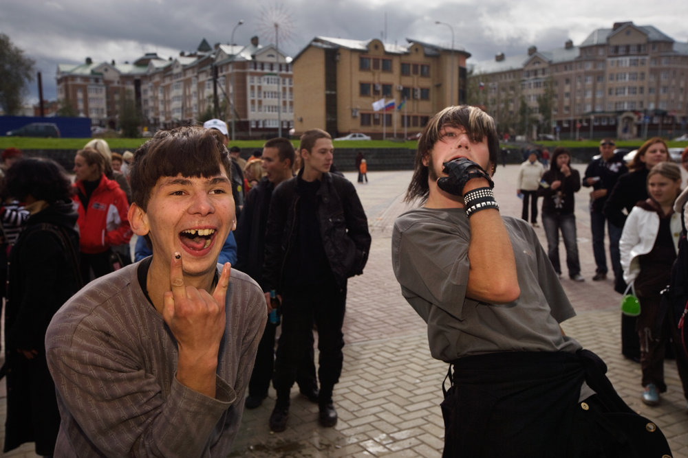 Boisterous teens gather in a square for festivities on City Day, a holiday honoring the metropolis and its citizens.  Khanty-Mansiysk, Russia