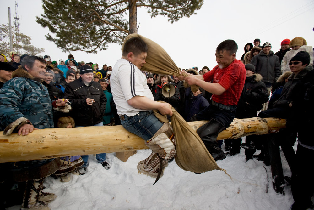 "Traditional events and competitions during the Khanty-Mansiysk region's annual ""Fishing and Hunting Day"" include the popular fight-on-a-log.  Russkinskaya, Russia"