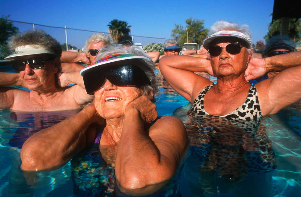 "Salton City's low costs and hot climes attract thousands of retirees, or ""snowbirds"" like these women, enjoying morning pool exercises at the Fountain Of Youth Spa.  Niland"