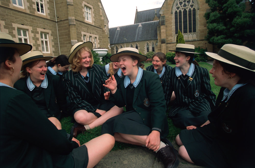 Looking forward to the Christmas/Summer break, a group of students at St. Mary's College, a Catholic High School for girls in Hobart gather on the College lawn during their last day of school.  Hobart