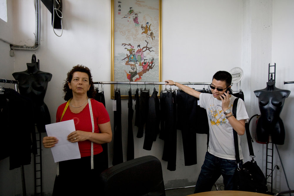 "Petro, born Hu Bing Laing, makes his morning rounds among some of the businesses his family manages, including a clothing design studio, where mostly Italian employees produce showroom pieces, often ""inspired"" by popular high-end designers."