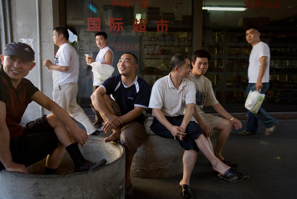 Friends gather on Via Pistoiese, Chinatown's central street in Prato.