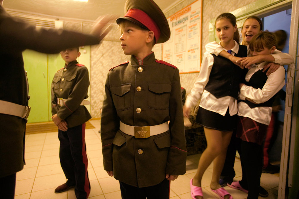 Descendants of the first wave of Siberian conquerors, young Cossacks in Yeniseisk gather in their dorm hallway.  Yeniseisk, Russia