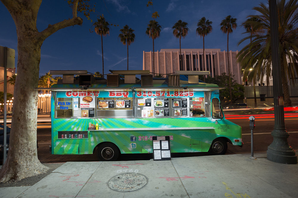 Food trucks gather outside of the Los Angeles County Museum of Art every day for lunch, sometimes staying into the evening, serving to both the museum's visitors as well as the employees from adjacent corporate offices. Food truck gathering spots such as this one are also popular destinations for tourists.  Los Angeles, CA.