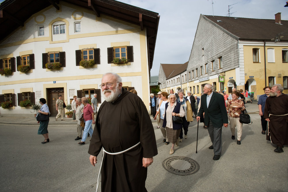 Once peaceful, reflective and idyllic, Marktl's square is now full of people who have come to photograph themselves, family, and friends in front of the birthplace of Pope Benedict XVI.  Marktl, Germany