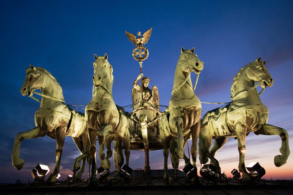 The Quadriga crowns the Brandenburg Gate, Berlin's trademark triumphal arch. The four-horse chariot was looted by Napoleon in 1806 but returned after his defeat in the Battle of the Nations.  Berlin, Germany