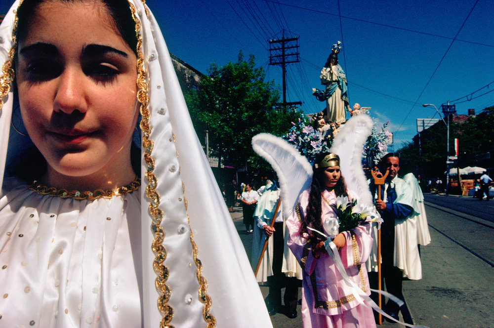 Children of Portuguese immigrants reaffirm spiritual ties to their parents' homeland at the feast of Senor de Petra, which honors the suffering of Christ.