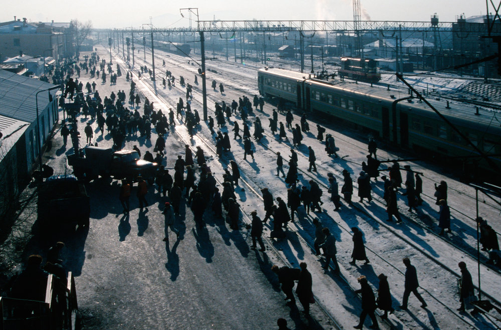 Travelers pass through a busy cargo terminal at the Ulan Ude Station.  Ulan Ude, Russia