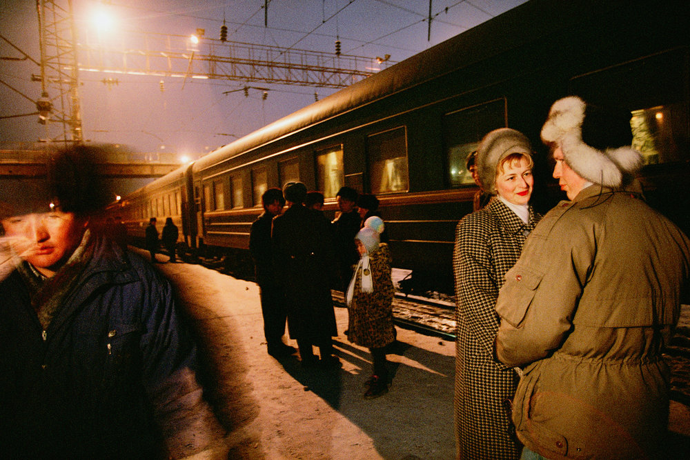 """Soldiers and civilians await a twilight departure from Krasnoyarsk. The station also serves two """"secret cities,"""" unmarked on Soviet-era maps, that produce plutonium and military electronics.  Krasnoyarsk, Russia"""