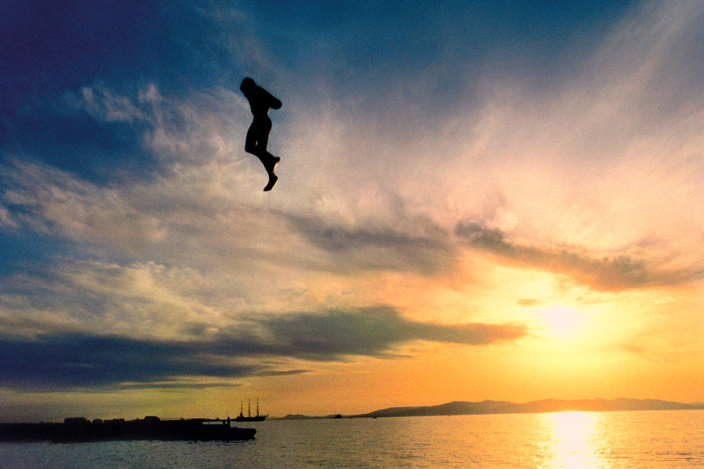 A swimmer jumps into the Sea of Japan in Vladivostok, a Russian traditional summer vacation spot.  Vladivostock, Russia