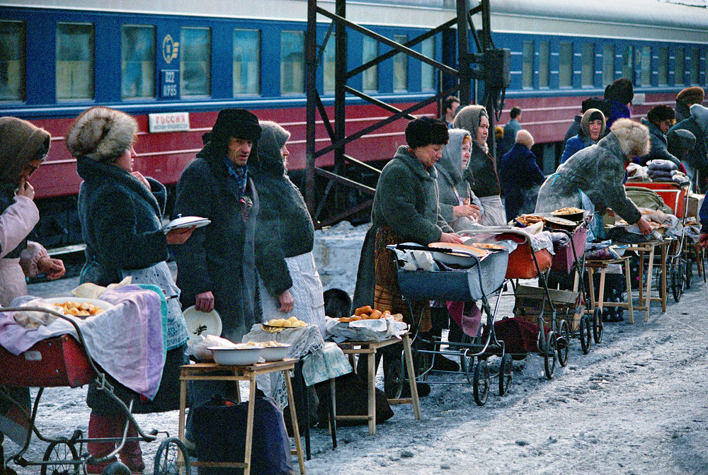 Babushkas load baby carriages with pans of home-cooked food and garden produce to sell at Petrovskiy Zavod. Many struggle to supplement government pensions worth only about $60 a month.  Petrovskiy Zavod, Russia