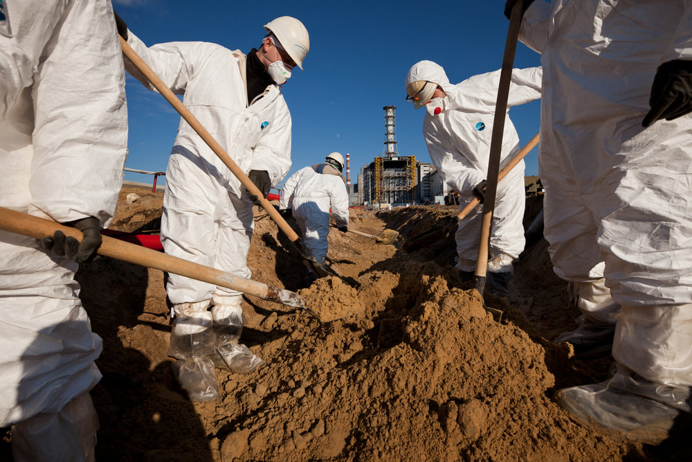 Clad in protective overalls and facemasks Novarka workers prepare the ground for the construction of New Safe Confinement.  Chernobyl Nuclear Power Plant, Ukraine
