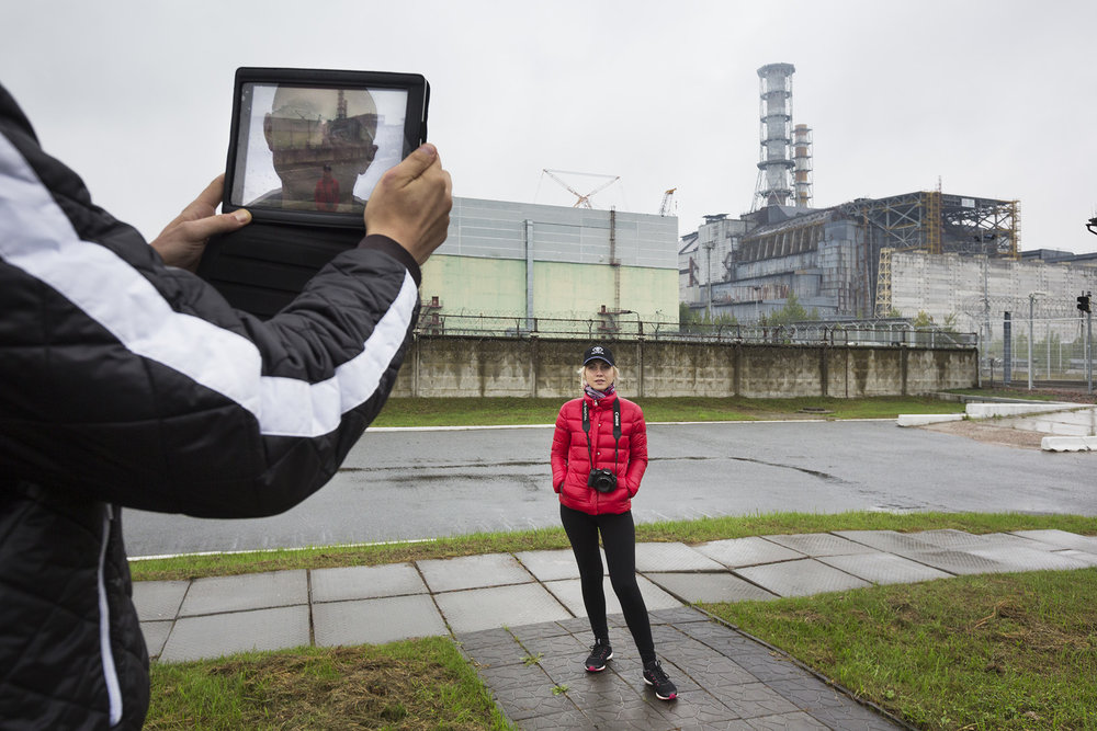 Tourists only have a few minutes to photograph the sarcophagus that incases the failed reactor #4.  Chernobyl Nuclear Power Plant, Ukraine