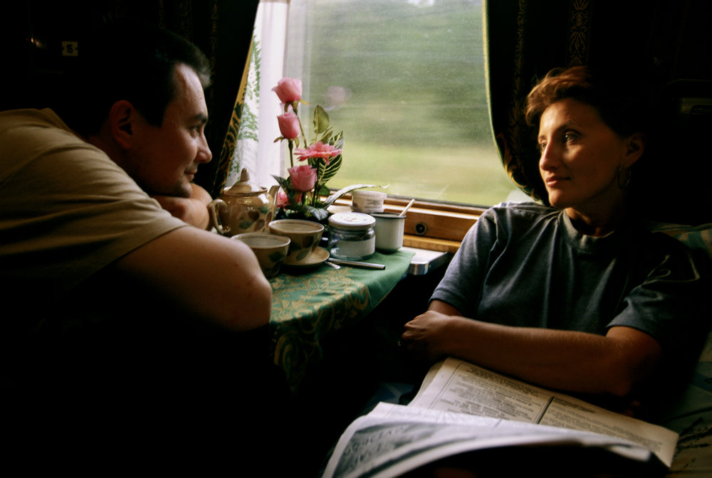A couple who met aboard the Trans-Siberian savor a first-class moment together.  The Urals, Russia
