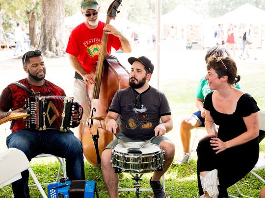 Zydeco musician Lil Nate, left, discusses and demonstrates his creative process May 27 at the Blue Moon Saloon during the South Louisiana Songwriters Festival. (Photo: David Simpson)