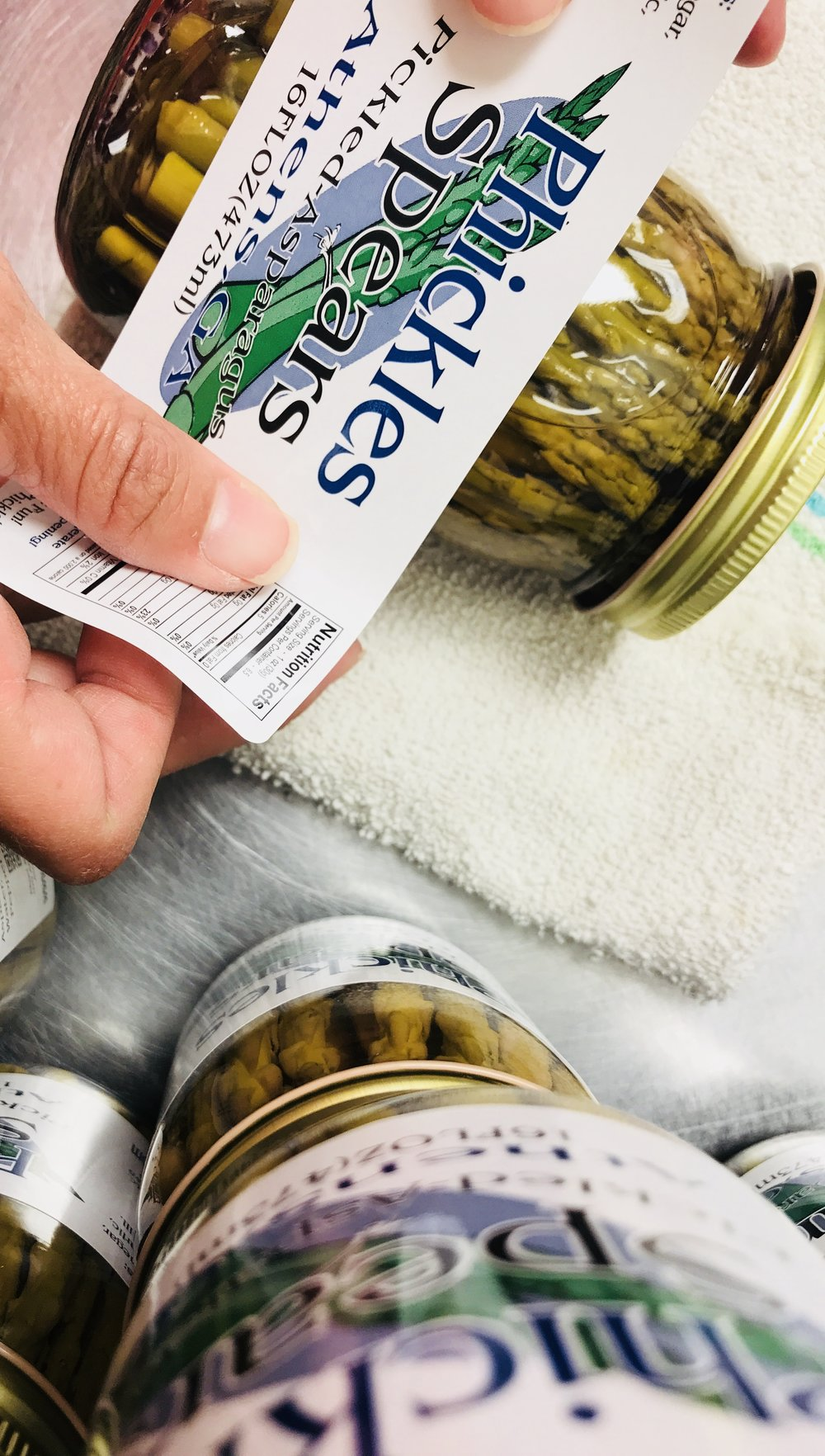 Just like we hand pack and hand pour every jar of our pickles, we hand label them too. 😊