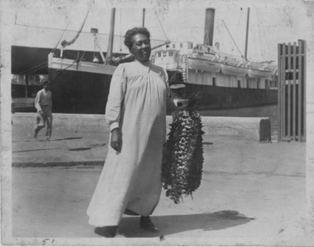 Lei vendor at the harbor during the 1930's.  Source: Hawaiʻi State Archives Digital Collection.