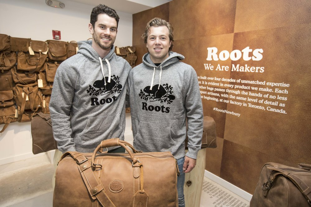 Boston Bruins players, Adam McQuaid and Charlie McAvoy, at Roots Legends on Newbury.