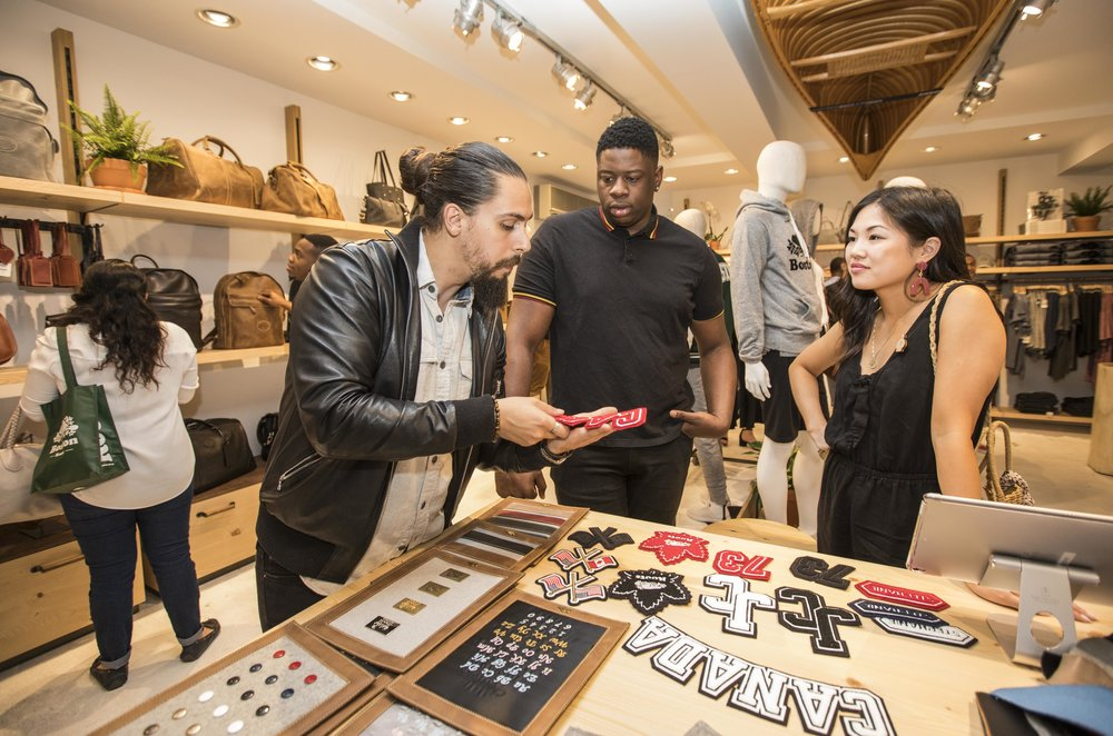 Guests exploring the Leather Customization Workshop at Roots Legends on Newbury.