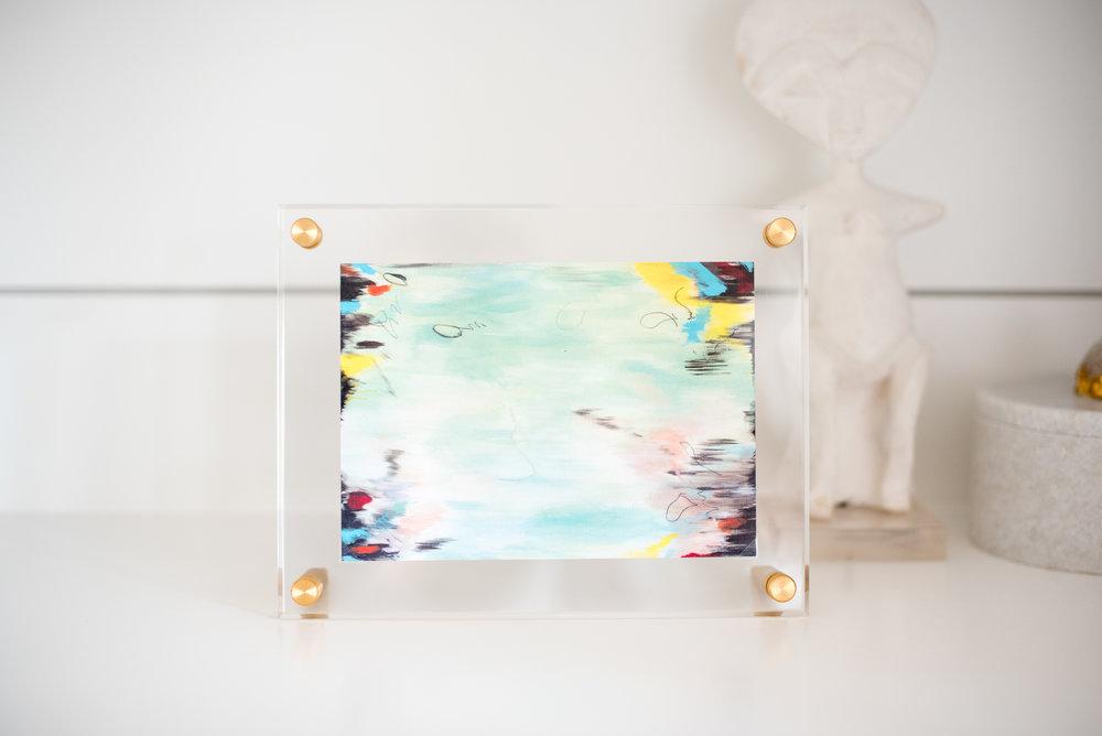 Framed in an acrylic art frame