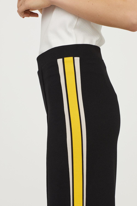 "Fashionable Pants with yellow ""Baseball-like"" Stripes"