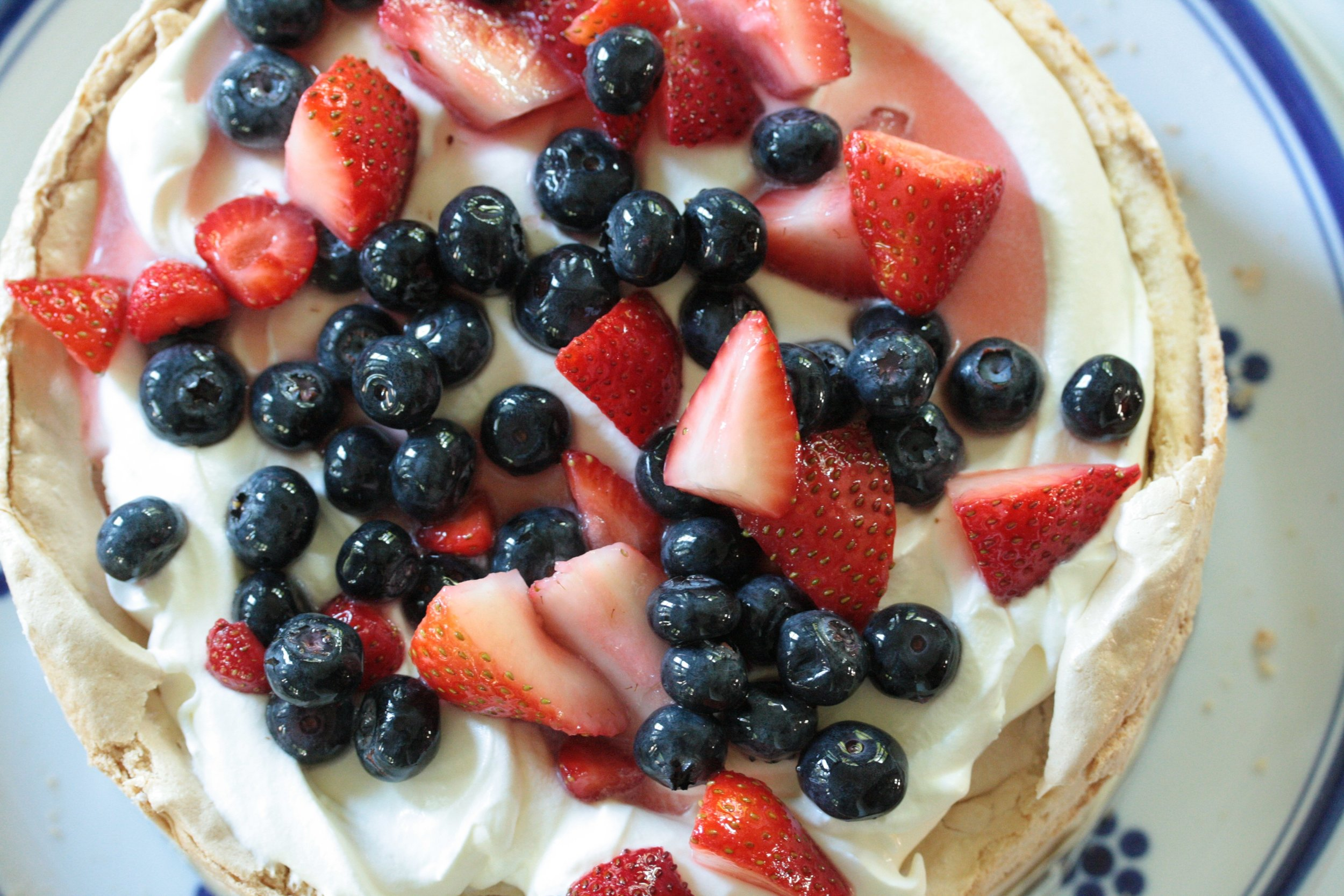berry covered top of brown sugar pavlova