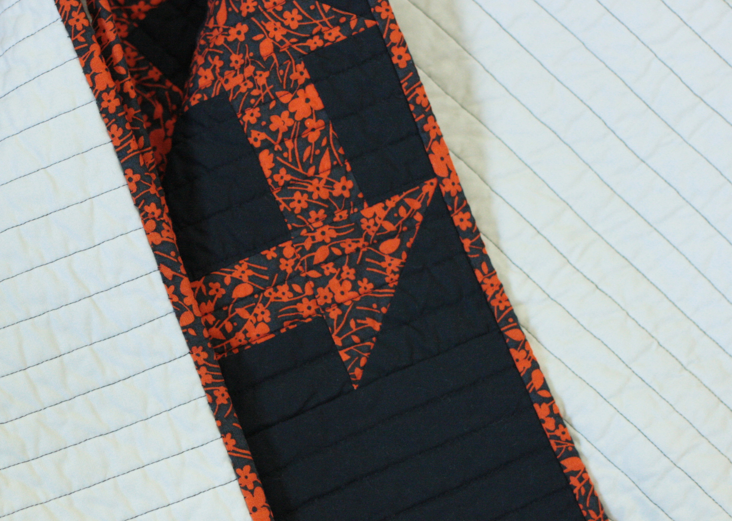 black channel quilting on pepper churn dash quilt