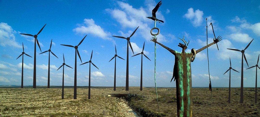 Windmills photoshopped into a sacred landscape.