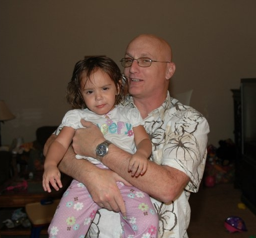Nick with one of his many grandchildren. Some called him Grandpa others called him Papa and he loved each one of them.
