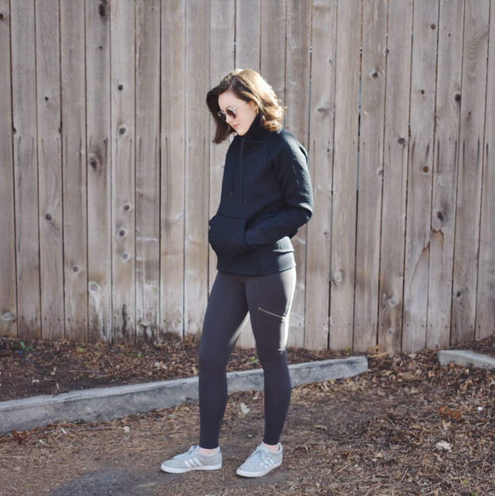 This isn't just your regular pullover. There's texture and design, the fabric is soft, and it has a cool structure. I've paired it with my favorite Athleta leggings (that have working pockets, those zippers are not just there for show), and my go-to Adidas sneakers. {they are so worn out that I didn't even take an up-close pic of them.}I've add some earrings and curled my hair to help dress up the look,just a little bit. I can also pair the pullover with jeans and instantly I've gone from athletic leisure to casual wear.