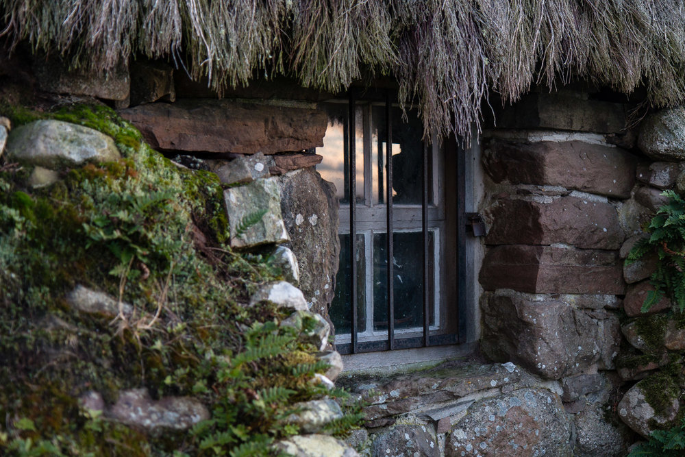 The battlefield reflected in Leanach Cottage window at Culloden