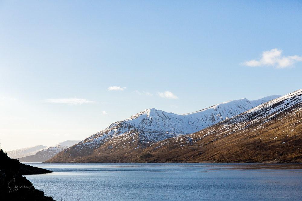 Snow capped peaks over Loch Mullardoch