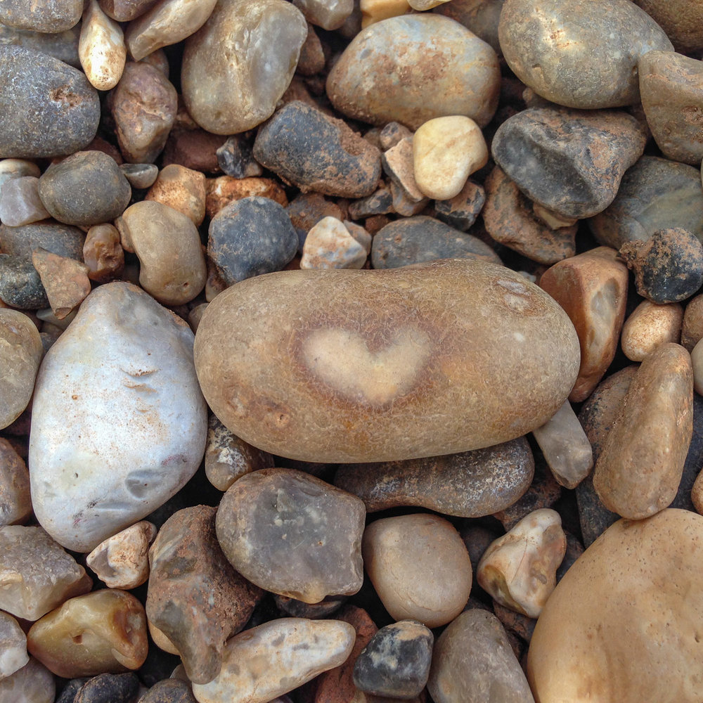 Orange pebble with a heart