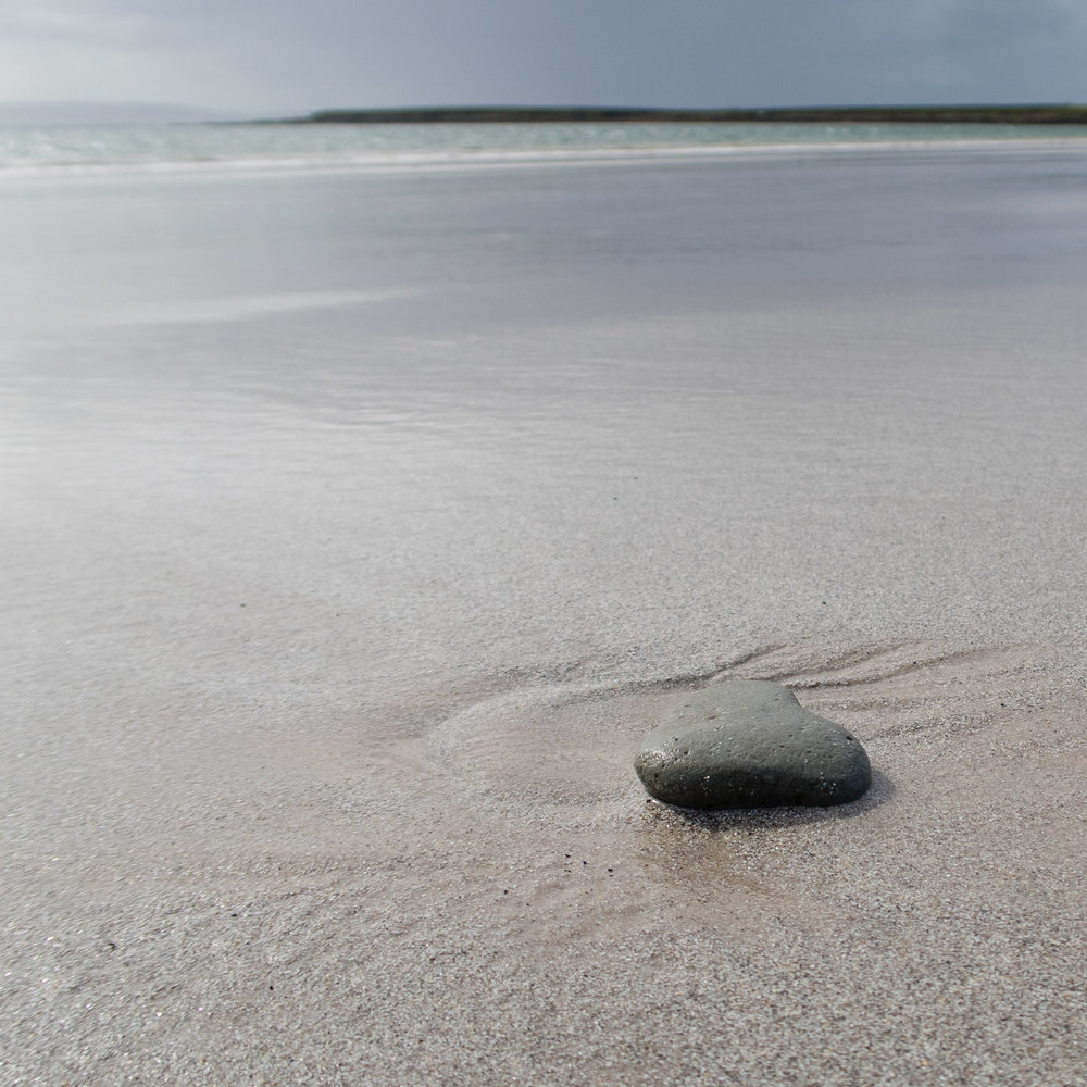 Heart shaped pebble on Bay of Tafts, Westray