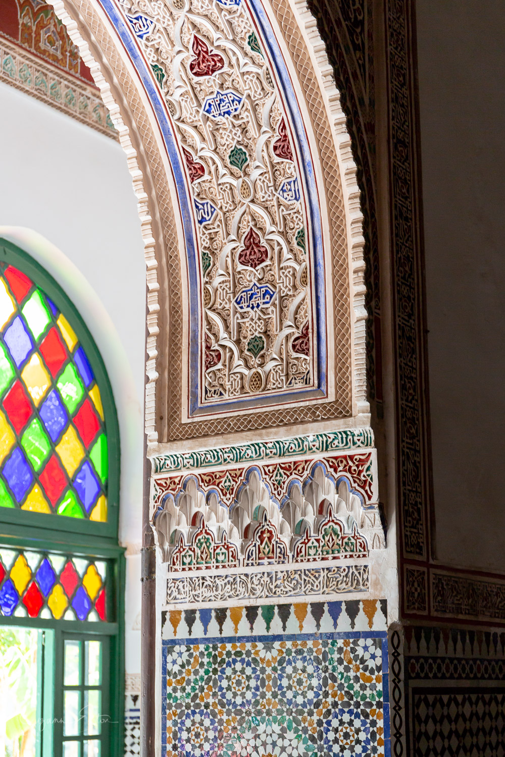 Carvings and stained glass at Palais Bahia in Marrakech