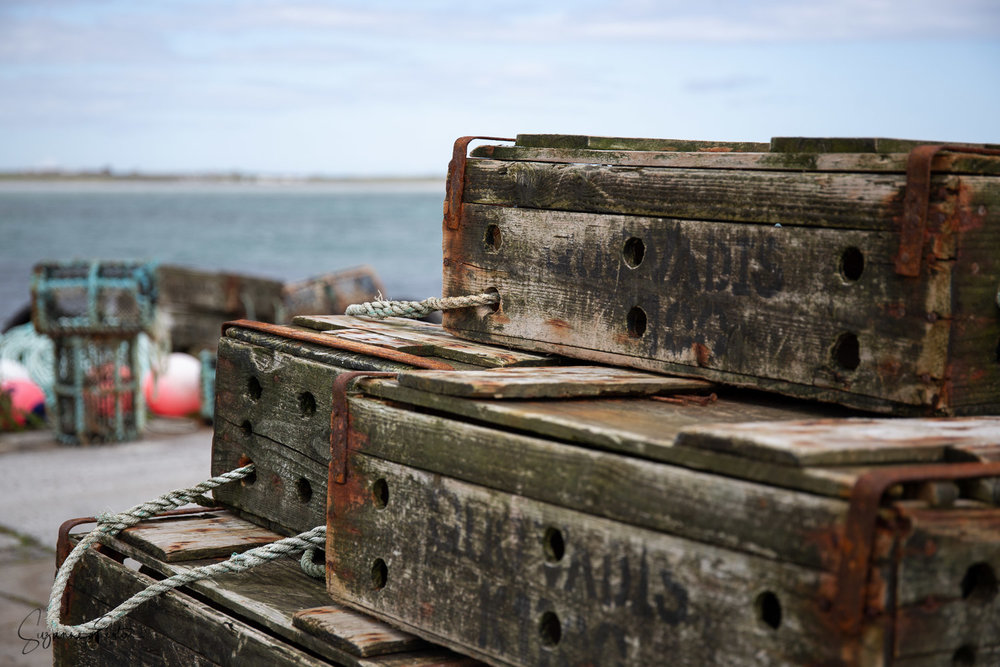 Fish boxes stacked on the pier at Kettletoft