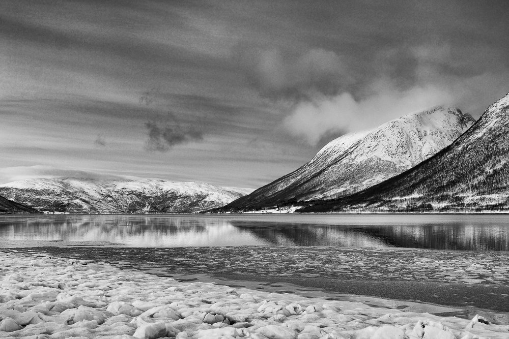 A frozen fjord in Norway close to Tromso in black and white
