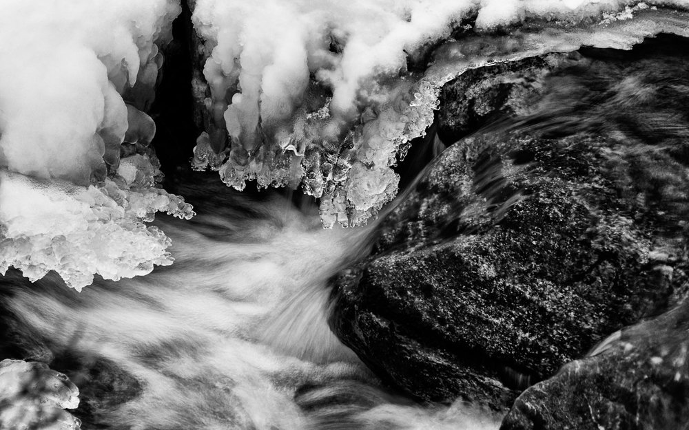 A frozen river in black and white